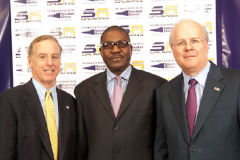 Dr. Somide with former Vermont Governor and Democratic presidential candidate, Doctor Howard Dean and Republican campaign strategist Karl Rove at an event